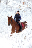Winter trail rider  gets out snowdrift