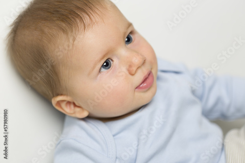 Close up portrait of sweet baby boy with blue eyes.