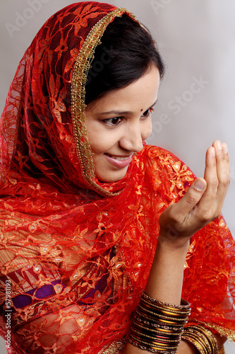 Young Muslim woman praying