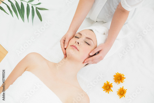 Hands massaging a beautiful woman's face
