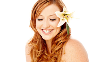 Beauty woman with a lily flower
