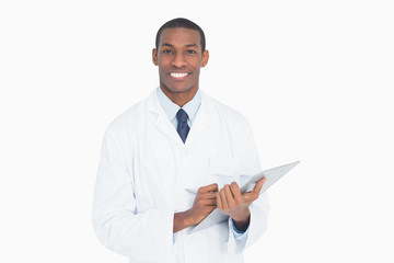 Portrait of a smiling male doctor with clipboard