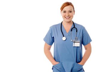 Female physician posing against white