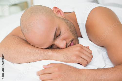 Close up of a young man sleeping in bed