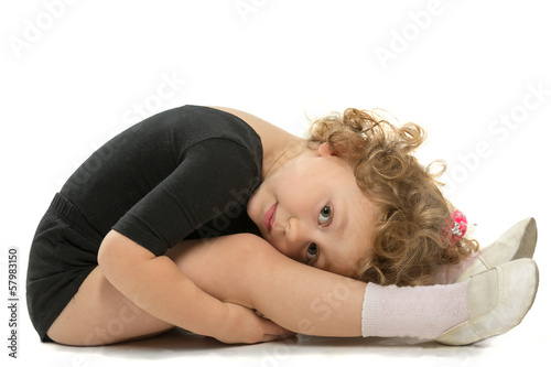 The little girl in a gymnastic bathing suit