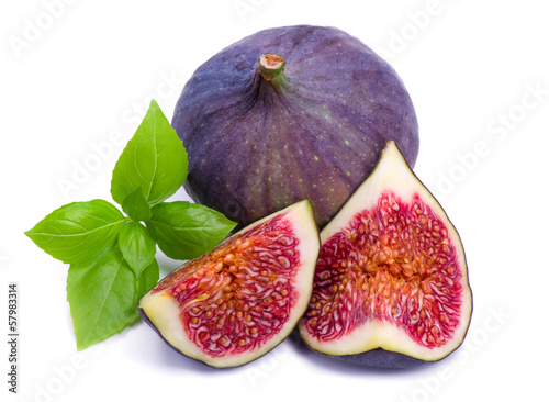 Ripe, beautiful fig with green leaf basil isolated on white