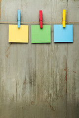 colorful notes hanging on a wooden background
