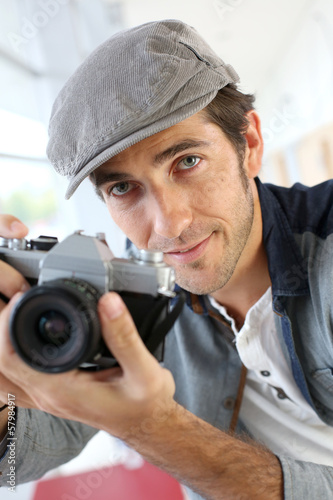 Photographer in studio using old-fashioned camera