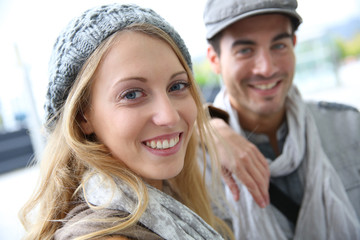 Cheerful young couple wearing hat in fall season