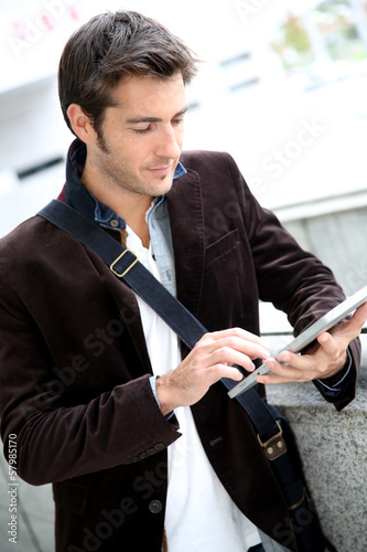 Young man connected on internet with tablet