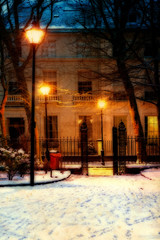 Vintage Georgian houses in traditional winter evening snow scene
