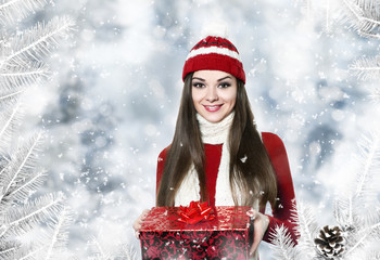 Beautiful young woman with christmas gift