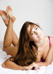 beauty brunette woman in pink lingerie