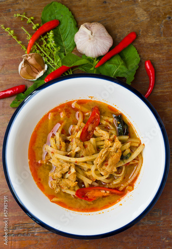 Thai hot and spicy curry with chicken and bamboo shoot on table