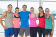Portrait of a group of fitness class at exercise room