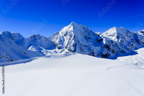 Fotobehang Alpen Winter mountains- snow-capped peaks of the Alps