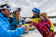 Winter, ski - skiers enjoying lunch in winter mountains