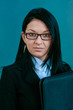 portrait of a executive woman with folder on the cold background
