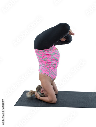 Pregnant fitness woman make stretch on yoga and pilates pose