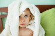 Toddler girl wearing bathrobe after bathing