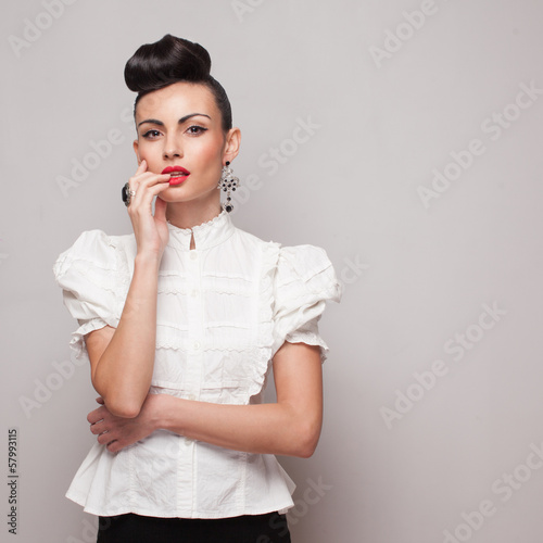 Vintage model posing in white shirt on grey background
