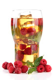 Iced tea with raspberries and mint isolated on white