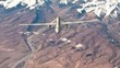 Military air drone fires missiles at ground targets