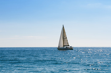 Small sailing boat in blue and calm sea