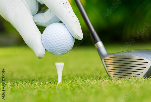 canvas print picture Close up view of golf ball on tee on golf course