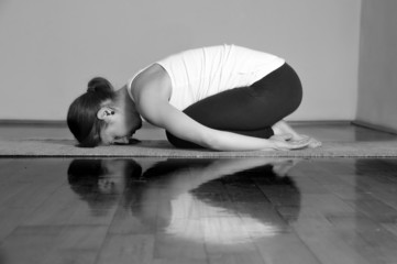 Girl doing Balasana yoga pose