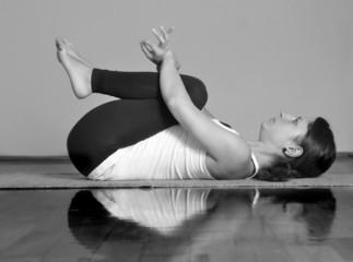 Girl doing Apanasana yoga pose
