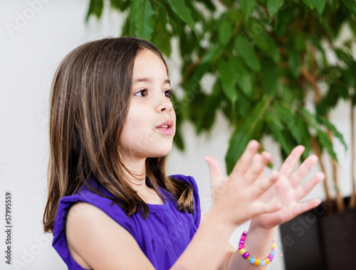 Portrait of happy cute child clapping hands