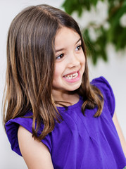 Expressive portrait of very cute smiling child