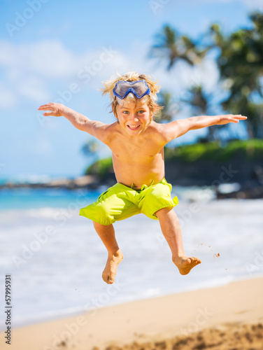 Happy young boy at the beach
