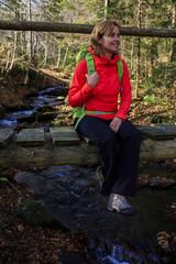Autumn trek - woman on mountain hike