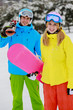 Ski, snowboard - couple enjoying winter holiday
