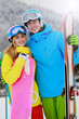 Ski and fun, young couple enjoying winter holiday
