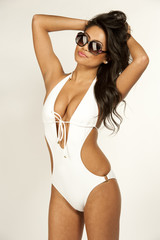 A young model in a tight, white, open bathing suit