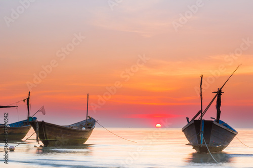 boats in the sea under sunset