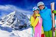 Ski and fun, young couple enjoying winter holiday