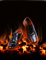 Business shoes dancing over fire