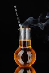 Laboratory beaker on black background