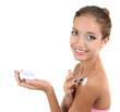 Beautiful girl moisturizing body cream close-up isolated