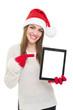 Happy Santa girl pointing at tablet computer screen