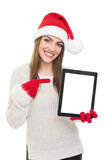 Happy Santa girl pointing at tablet computer screen