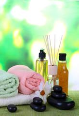 Beautiful spa setting on bamboo mat on bright background