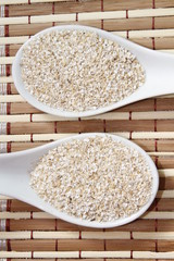 oat bran on white ceramic spoon