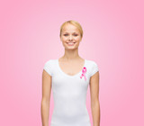 woman in blank t-shirt with pink cancer ribbon