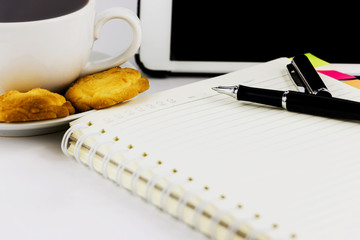 Cup of coffee,tablet computer,book and pen isolated on white bac