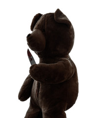 strange killer teddy bear holding bloody knife  silhouette